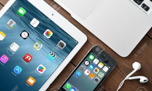 36459768-kiev-ukraine-january-29-2015-apple-iphone-5s-ipad-air-2-and-macbook-air-on-table-apple-inc-